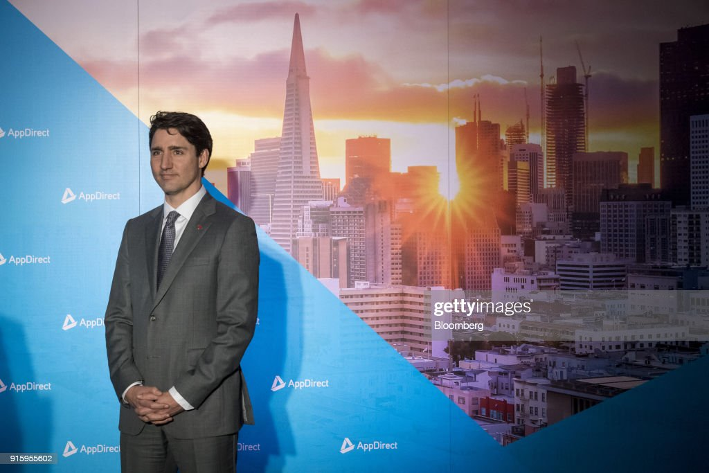 Justin Trudeau, Canada's prime minister, listens as Daniel Saks, president and co-chief executive officer of AppDirect Inc., not pictured, speaks during a press conference in San Francisco, California, U.S., on Thursday, Feb. 8, 2018. Technology and innovation is at the center of Trudeau's economic vision for Canada, so his visit to San Francisco is as much about symbolism as it is about drumming up new business. Photographer: David Paul Morris/Bloomberg via Getty Images