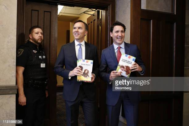 Justin Trudeau Canada's prime minister right and Bill Morneau Canada's finance minister center arrive at the House of Commons before tabling the...