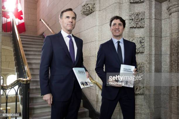 Justin Trudeau Canada's prime minister right and Bill Morneau Canada's finance minister arrive at the House of Commons before tabling the federal...