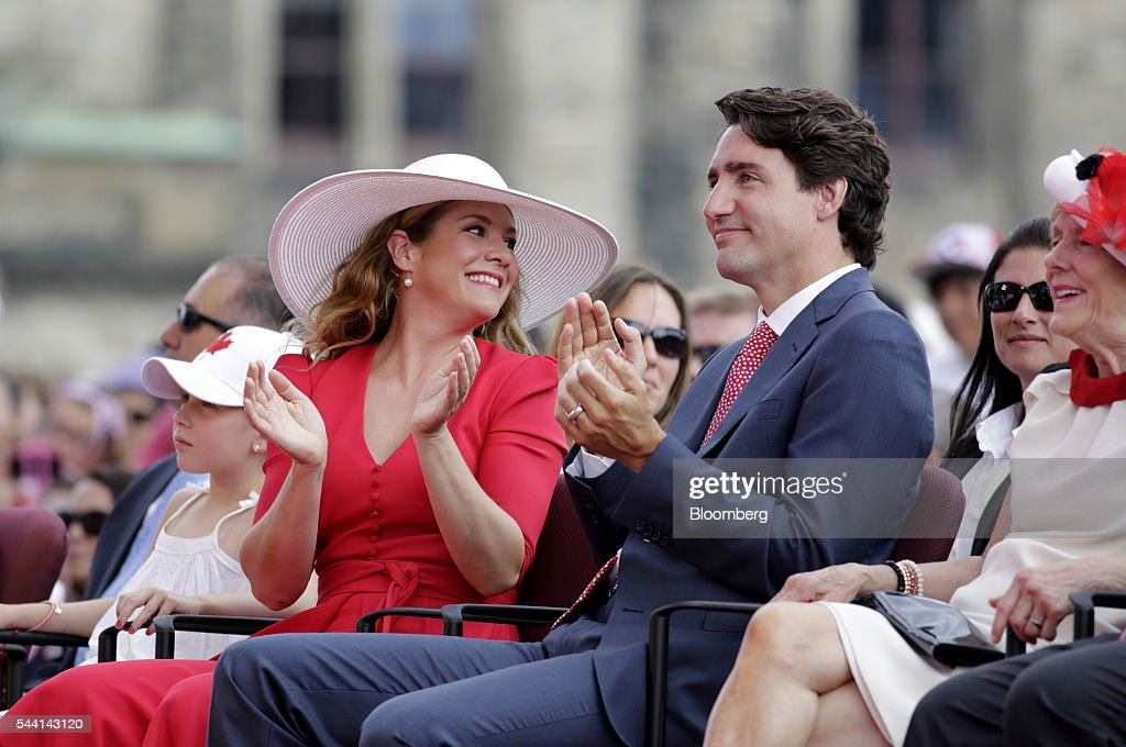 Justin Trudeau, Canada's prime minister, right, and wife Sophie Gregoire Trudeau, left, applaud during Canada Day performances on Parliament Hill in Ottawa, Ontario, Canada, on Friday, July 1, 2016. On July 1, thousands of locals and tourists gather in Ottawa's downtown area to celebrate. This year marks Canada's 149th birthday and Trudeau's first Canada Day as Prime Minister. Photographer: David Kawai/Bloomberg via Getty Images