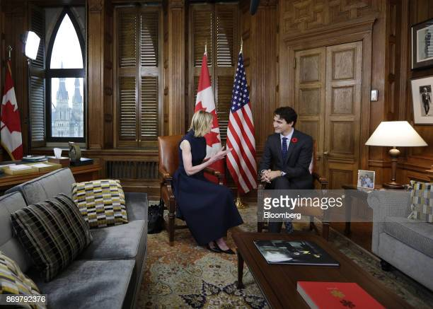 Justin Trudeau Canada's prime minister right listens as Kelly Craft US ambassador to Canada speaks during a meeting in his office at Parliament Hill...