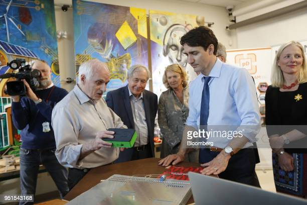 Justin Trudeau Canada's prime minister right listens while Dan Craigen founding president of Global EPIC displays an affordable cybersecurity device...