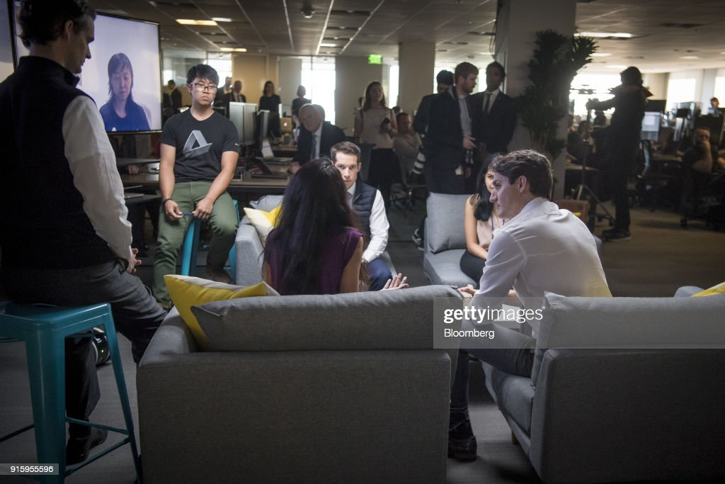 Justin Trudeau, Canada's prime minister, right, meets with employees of AppDirect Inc., in San Francisco, California, U.S., on Thursday, Feb. 8, 2018. Technology and innovation is at the center of Trudeau's economic vision for Canada, so his visit to San Francisco is as much about symbolism as it is about drumming up new business. Photographer: David Paul Morris/Bloomberg via Getty Images