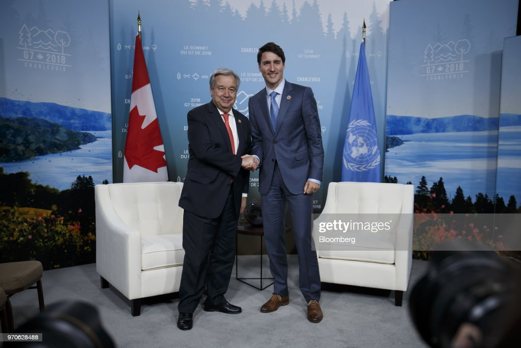 Justin Trudeau, Canada's prime minister, right, shakes hands with Antonio Guterres, secretary-general of the United Nations (UN), during a bilateral meeting at the Group of Seven (G7) Leaders Summit in La Malbaie, Quebec, Canada, on Saturday, June 9, 2018. PresidentDonald Trumptold U.S. officials not to endorse the Group of Seven's final communique and accused Trudeauof making 'false statements' at the summit's closing press conference. Photographer: Cole Burston/Bloomberg via Getty Images