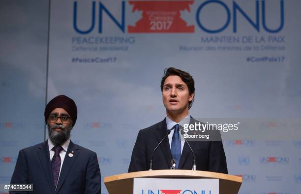 Justin Trudeau Canada's prime minister right speaks as Harjit Sajjan Canada's defense minister listens during the 2017 UN Peacekeeping Defence...
