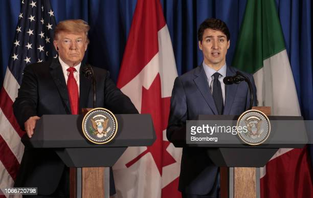 Justin Trudeau Canada's prime minister right speaks as US president Donald Trump listens before the signing of the United StatesMexicoCanada...