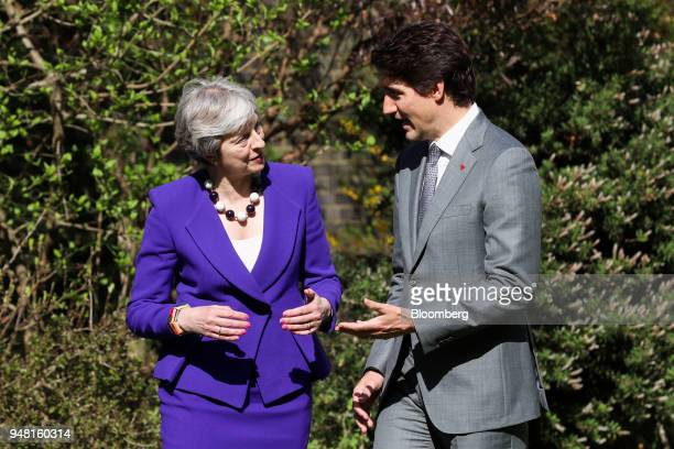 Justin Trudeau Canada's prime minister right speaks to Theresa May UK prime minister during a bilateral meeting in the gardens of number 10 Downing...
