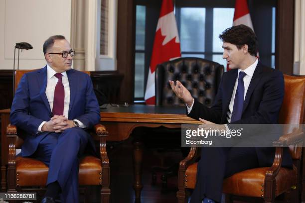 Justin Trudeau Canada's prime minister right speaks while Alan Kestenbaum chief executive officer ofStelcoHoldings Inc listens during a photo...