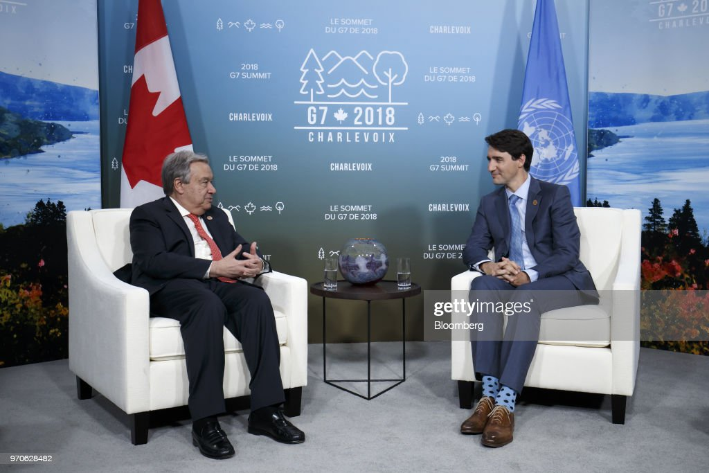 Justin Trudeau, Canada's prime minister, right, speaks with Antonio Guterres, secretary-general of the United Nations (UN), during a bilateral at meeting the Group of Seven (G7) Leaders Summit in La Malbaie, Quebec, Canada, on Saturday, June 9, 2018. PresidentDonald Trumptold U.S. officials not to endorse the Group of Seven's final communique and accused Trudeauof making 'false statements' at the summit's closing press conference. Photographer: Cole Burston/Bloomberg via Getty Images