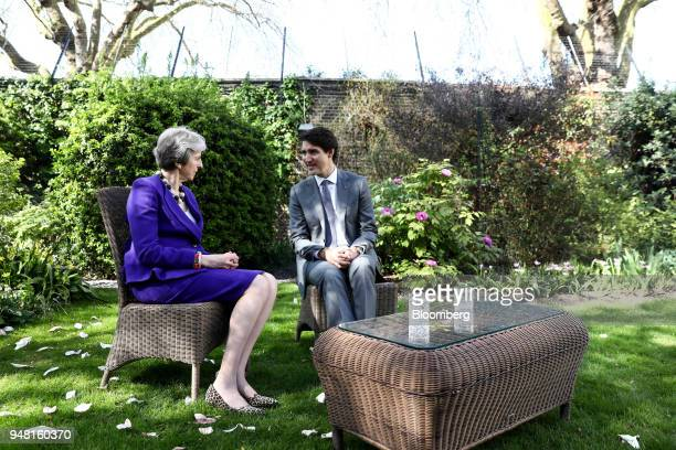 Justin Trudeau Canada's prime minister speaks to Theresa May UK prime minister left during a bilateral meeting in the gardens of number 10 Downing...