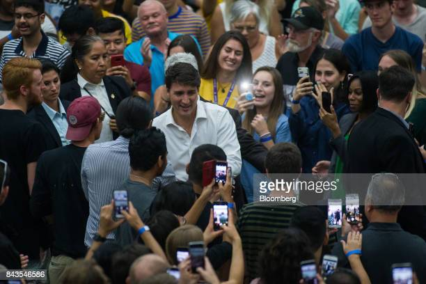 Justin Trudeau Canada's Prime Minister walks through a crowd while arriving at a town hall meeting at the University of British Columbia Okanagan...