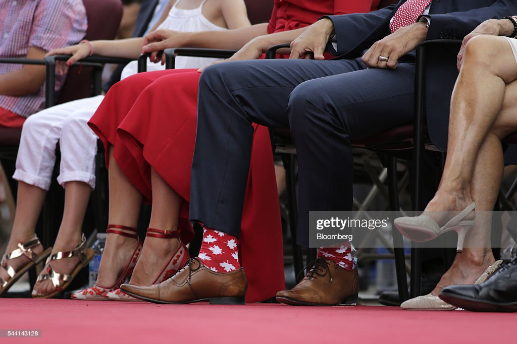 Justin Trudeau, Canada's prime minister, wears patriotic socks to Canada Day celebrations on Parliament Hill in Ottawa, Ontario, Canada, on Friday, July 1, 2016. On July 1, thousands of locals and tourists gather in Ottawa's downtown area to celebrate. This year marks Canada's 149th birthday and Trudeau's first Canada Day as Prime Minister. Photographer: David Kawai/Bloomberg via Getty Images
