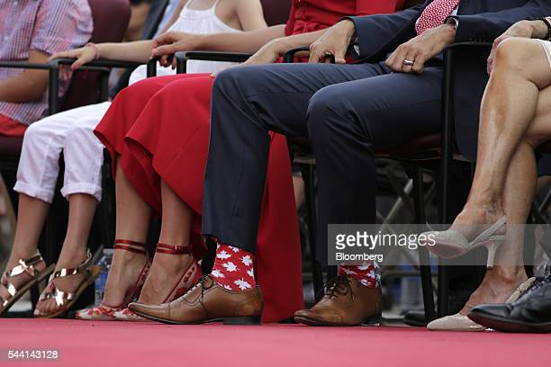 Justin Trudeau Canada's prime minister wears patriotic socks to Canada Day celebrations on Parliament Hill in Ottawa Ontario Canada on Friday July 1...