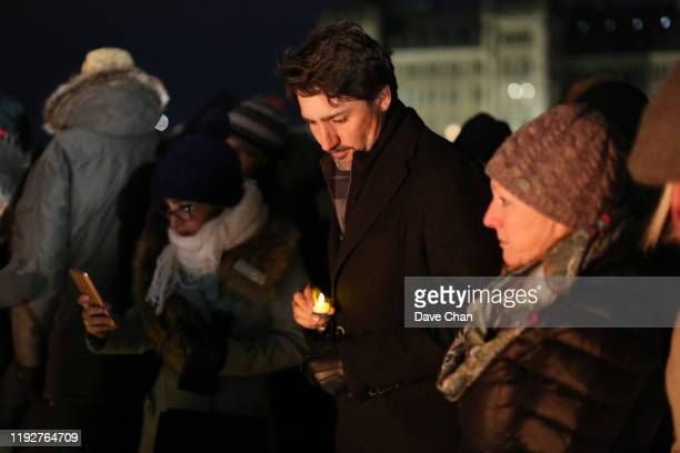 Justin Trudeau Prime Minister of Canada holds a candle on Parliament Hill during vigil for the victims who were killed in a plane crash in Iran on...