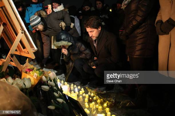 Justin Trudeau Prime Minister of Canada place a candle on Parliament Hill during vigil for the victims who were killed in a plane crash in Iran on...
