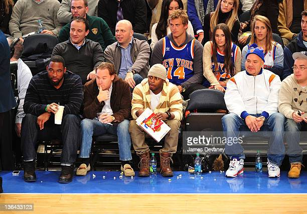 Justin Tuck and Fat Joe attend the Charlotte Bobcats vs the New York Knicks game at Madison Square Garden on January 4 2012 in New York City