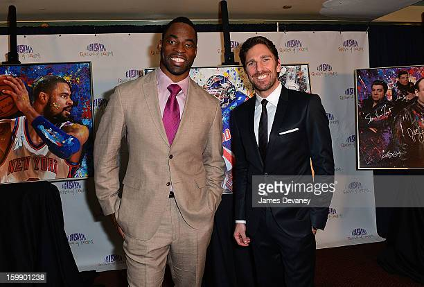 Justin Tuck and Henrik Lundqvist attend the Garden of Dreams Foundation Gallery Collection launch event at Madison Square Garden on January 22, 2013...