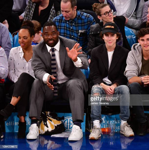 Justin Tuck and Timothee Chalamet attend Detroit Pistons v New York Knicks game at Madison Square Garden on February 5 2019 in New York City