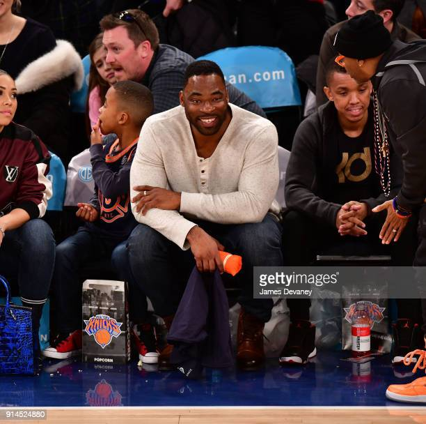 Justin Tuck attend the New York Knicks vs Atlanta Hawks game at Madison Square Garden on February 4 2018 in New York City