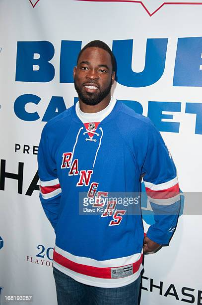 Justin Tuck attends the Washington Capitals vs New York Rangers 2013 Playoff Game Three at Madison Square Garden on May 6 2013 in New York City
