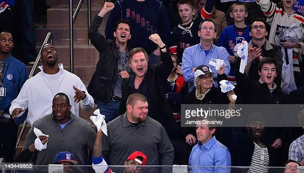 Justin Tuck Liam Neeson Vanessa Redgrave and Daniel Neeson attend the Ottawa Senators vs the New York Rangers Playoff Game at Madison Square Garden...
