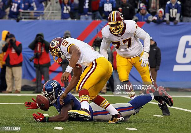 Justin Tuck of the New York Giants forces a fourth quarter fumble against Donovan Mcnabb of the Washington Redskins on December 5 2010 at the New...