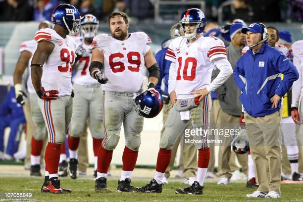 Justin Tuck Rich Seubert Eli Manning and head coach Tom Coughlin of the New York Giants look on during a challenge on a fumble by Manning late in the...