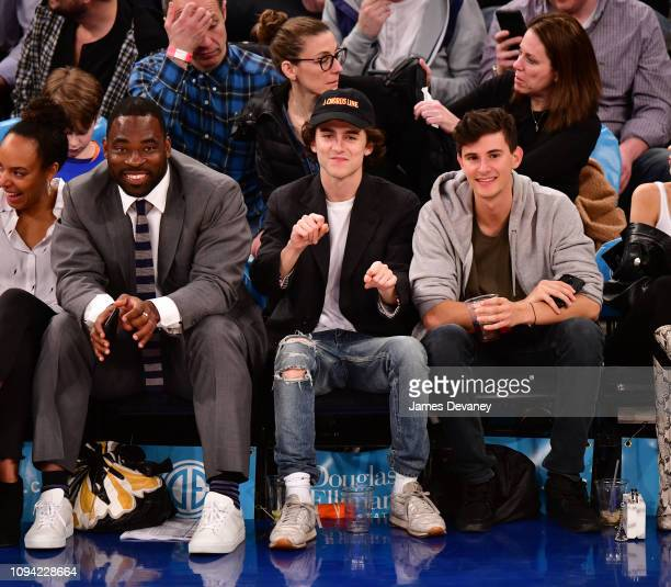 Justin Tuck Timothee Chalamet and guest attend Detroit Pistons v New York Knicks game at Madison Square Garden on February 5 2019 in New York City