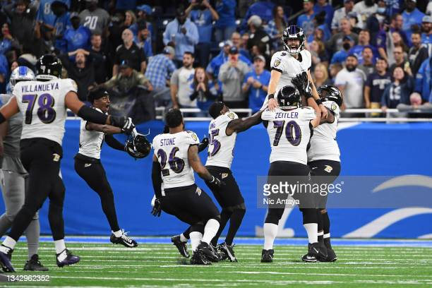 Justin Tucker of the Baltimore Ravens celebrates the winning field goal with his team in the game against the Detroit Lions at Ford Field on...