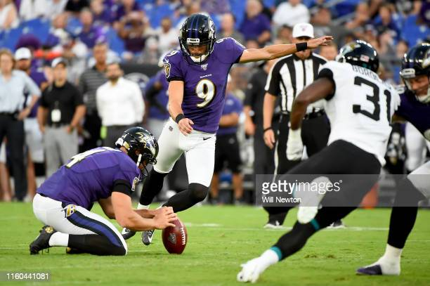 Justin Tucker of the Baltimore Ravens kicks and makes a field goal during the first half of a preseason game against the Jacksonville Jaguars at MT...