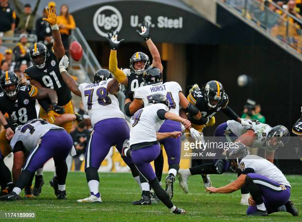 Justin Tucker of the Baltimore Ravens kicks the game winning field goal in overtime against the Pittsburgh Steelers on October 6 2019 at Heinz Field...