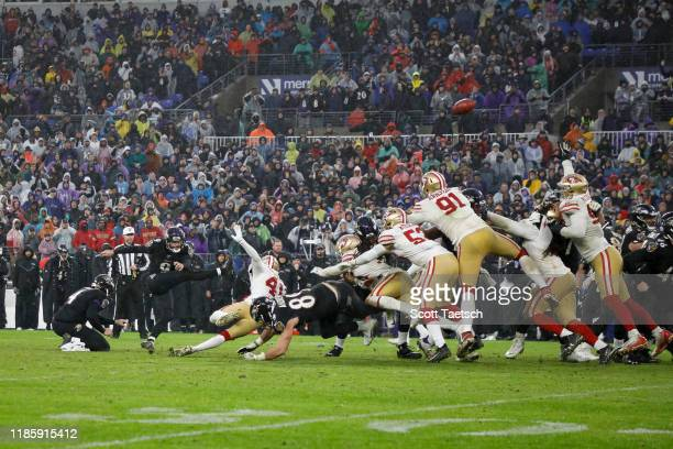 Justin Tucker of the Baltimore Ravens kicks the game winning field goal against the San Francisco 49ers in the second half at M&T Bank Stadium on...