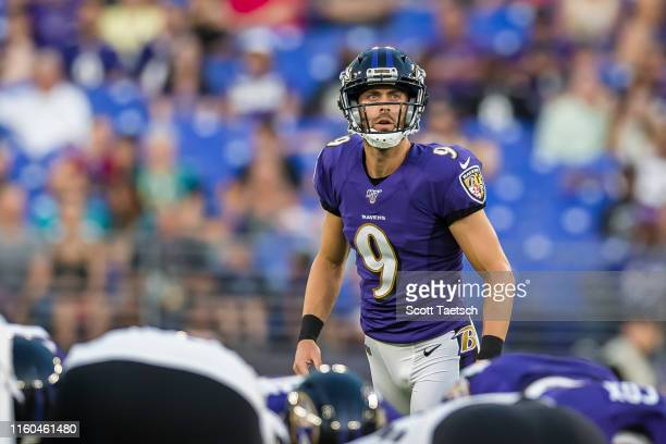 Justin Tucker of the Baltimore Ravens prepares to kick a field goal against the Jacksonville Jaguars during the first half of a preseason game at MT...