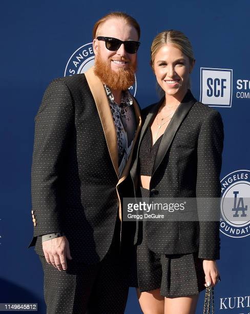 Justin Turner and Kourtney Pogue arrive at the 5th Annual Blue Diamond Foundation at Dodger Stadium on June 12 2019 in Los Angeles California