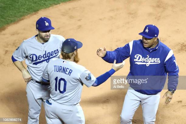 Justin Turner and manager Dave Roberts of the Los Angeles Dodgers shakes hands prior to Game One of the 2018 World Series against the Boston Red Sox...