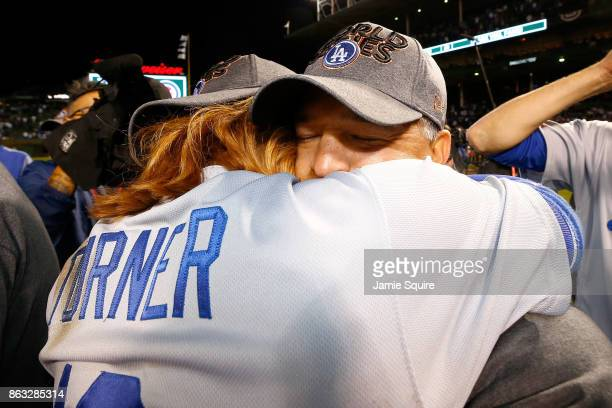 Justin Turner and manager Dave Roberts of the Los Angeles Dodgers celebrate after beating the Chicago Cubs 101 in game five of the National League...