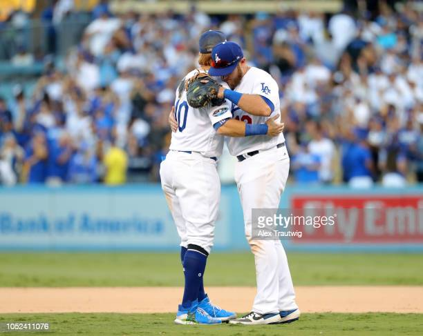 Justin Turner and Max Muncy of the Los Angeles Dodgers celebrate after winning Game 5 of the NLCS against the Milwaukee Brewers at Dodger Stadium on...