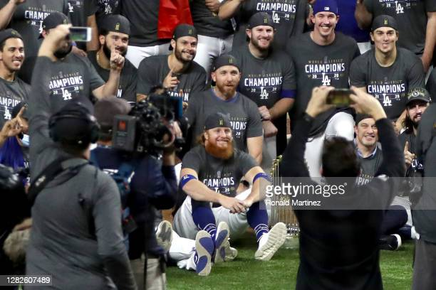Justin Turner and the Los Angeles Dodgers pose for a photo after defeating the Tampa Bay Rays 3-1 in Game Six to win the 2020 MLB World Series at...