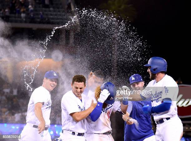Justin Turner of the Los Angeles Dodger celebrates his game winning single to score a run with Rich Hill Austin Barnes Alex Wood and Chris Taylor for...