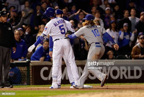 Justin Turner of the Los Angeles Dodgers attempts to tag Albert Almora Jr #5 of the Chicago Cubs in the ninth inning during game three of the...