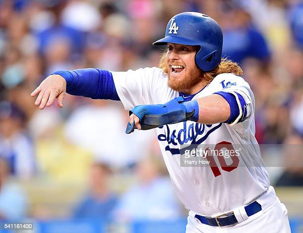 Justin Turner of the Los Angeles Dodgers calls for Adrian Gonzalez to slide after scoring his run to tie the game 1-1 with the Milwaukee Brewers...