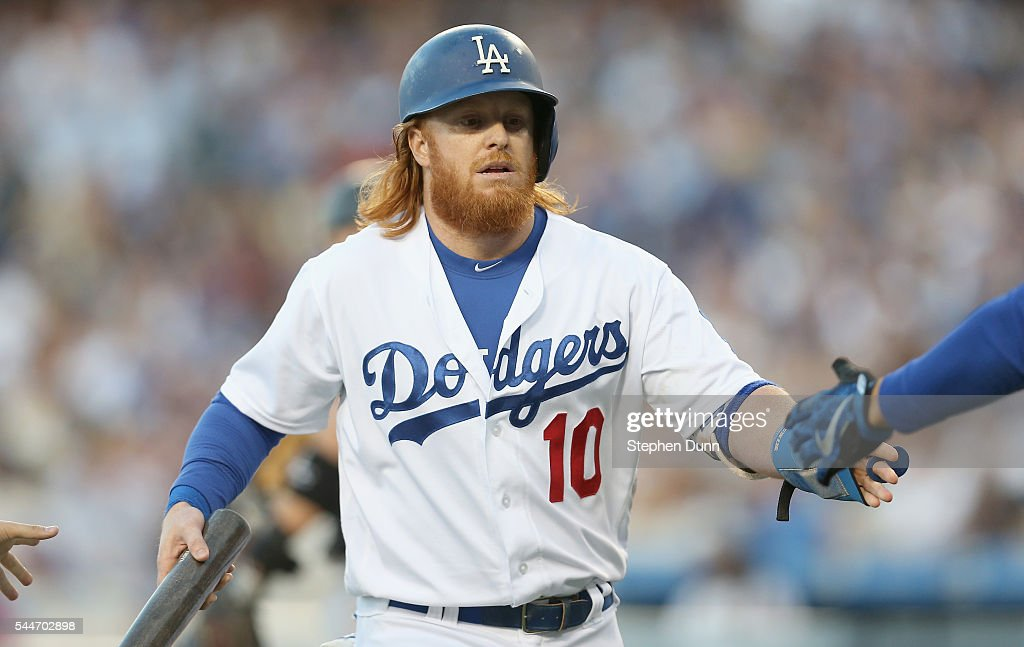 Justin Turner #10 of the Los Angeles Dodgers ceelbrates as he returns to the dugout after scoring a run in the first inning against the Colorado Rockies at Dodger Stadium on July 2, 2016 in Los Angeles, California.