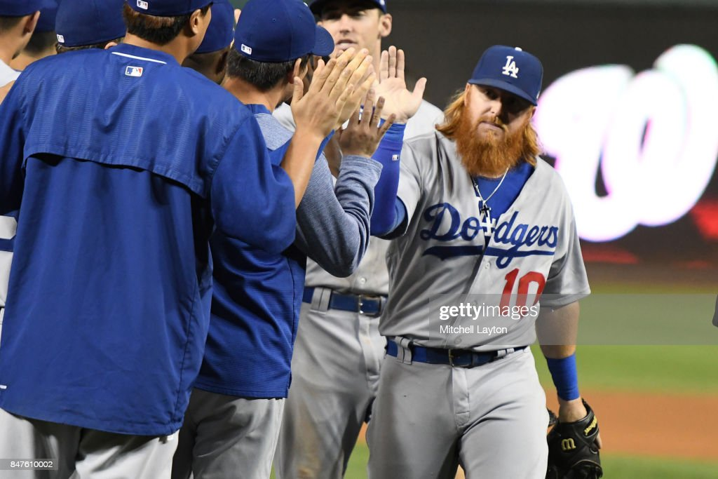 Justin Turner #10 of the Los Angeles Dodgers celebrates a win after a baseball game against the Washington Nationals at Nationals Park on September 15, 2017 in Washington, DC.