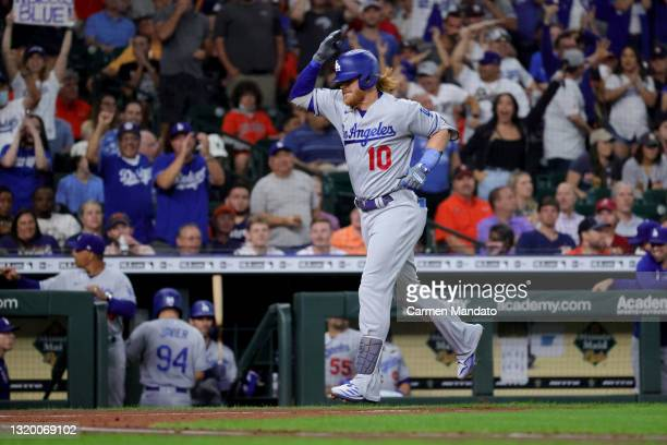 Justin Turner of the Los Angeles Dodgers celebrates after hitting a two run home run during the fourth inning against the Houston Astros at Minute...