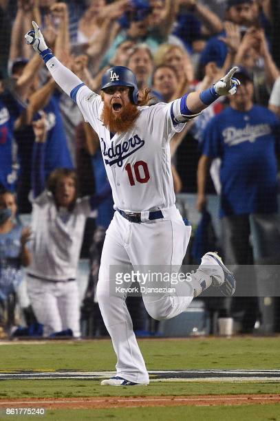 Justin Turner of the Los Angeles Dodgers celebrates after hitting a threerun walkoff home run in the ninth inning to defeat the Chicago Cubs 41 in...
