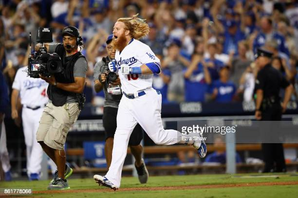 Justin Turner of the Los Angeles Dodgers celebrates after hitting the winning home run in the bottom of the ninth inning making the score 41 during...