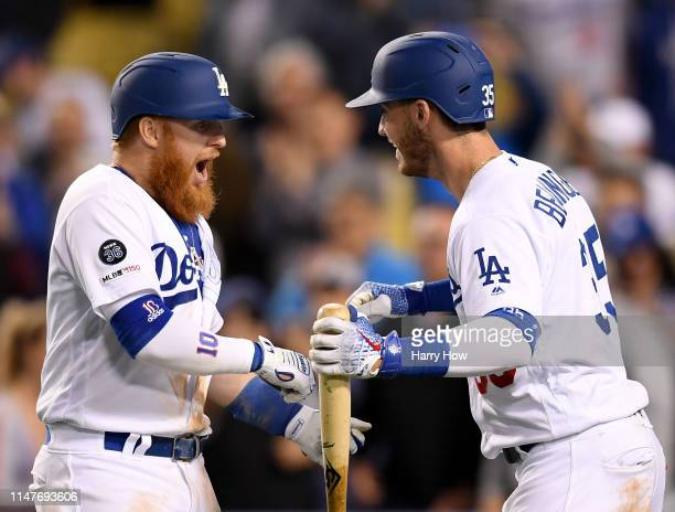 Justin Turner of the Los Angeles Dodgers celebrates his third homerun of the game with Cody Bellinger for a 90 lead over the Atlanta Braves during...