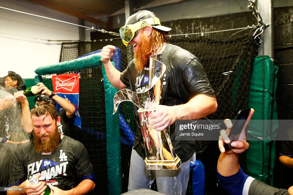 Justin Turner #10 of the Los Angeles Dodgers celebrates in the clubhouse after defeating the Chicago Cubs 11-1 in game five of the National League Championship Series at Wrigley Field on October 19, 2017 in Chicago, Illinois. The Dodgers advance to the 2017 World Series.