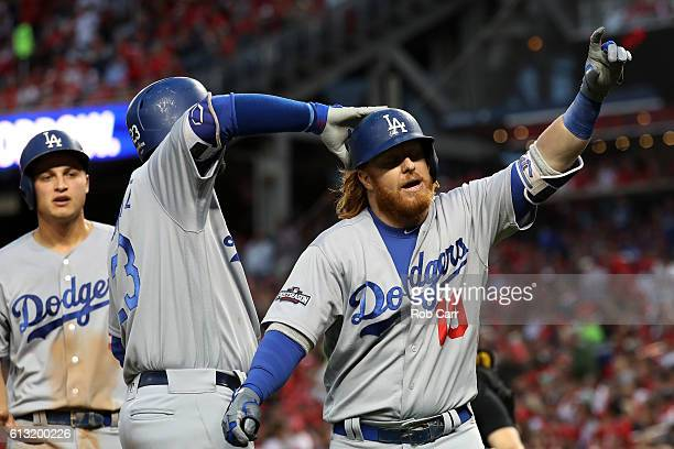 Justin Turner of the Los Angeles Dodgers celebrates with teammate Adrian Gonzalez after hitting a two run home run against the Washington Nationals...