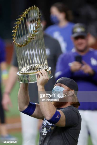 Justin Turner of the Los Angeles Dodgers celebrates with the Commissioner's Trophy after defeating the Tampa Bay Rays 31 in Game Six to win the 2020...